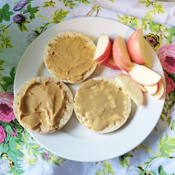 Corn cakes with nut butter and sliced apple