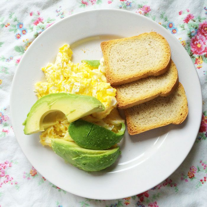 Scrambled eggs avocado and spelt melba toast