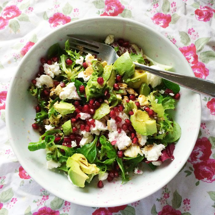 Salad with feta quinoa avocado pomegranate