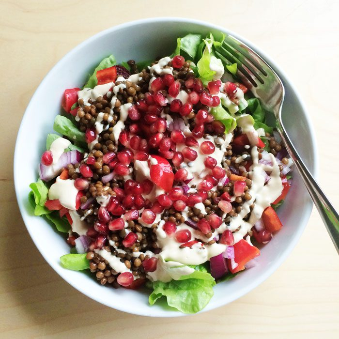 Lentil salad with tahini and pomegranate
