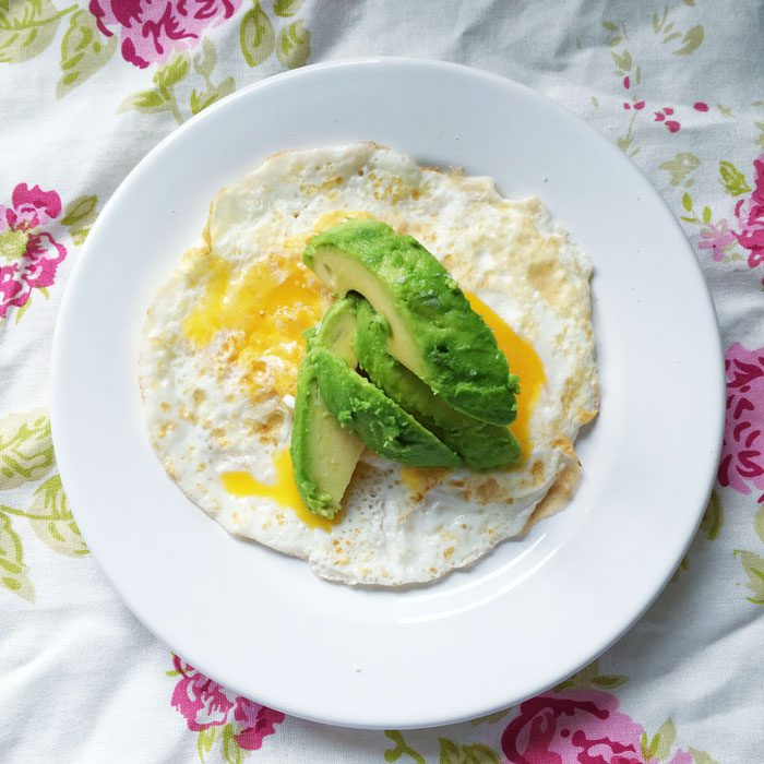 Coconut oil fried eggs and avocado