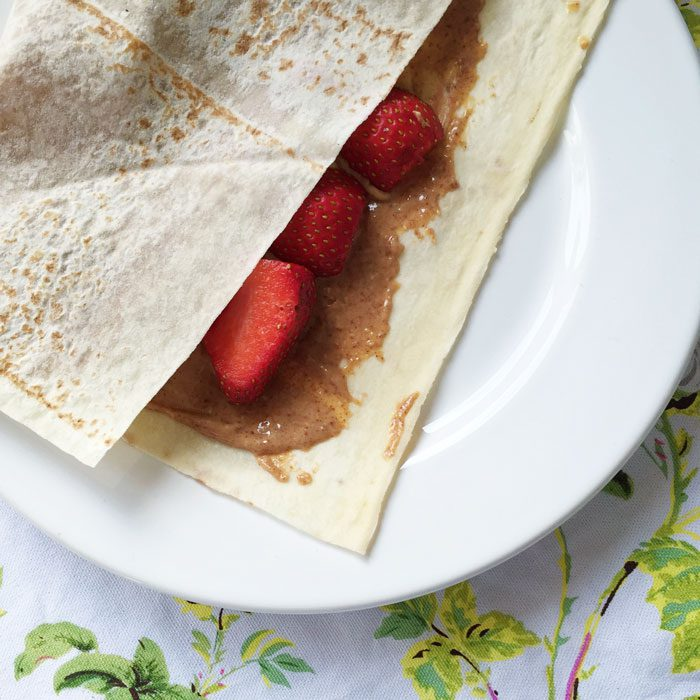 Mountain bread wraps with peanut butter and strawberries