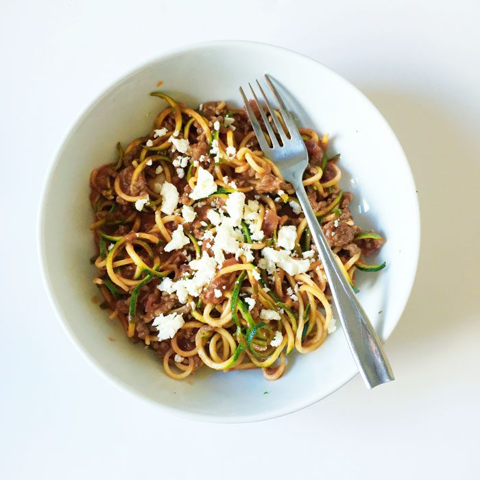 Courgetti with beef sauce and feta