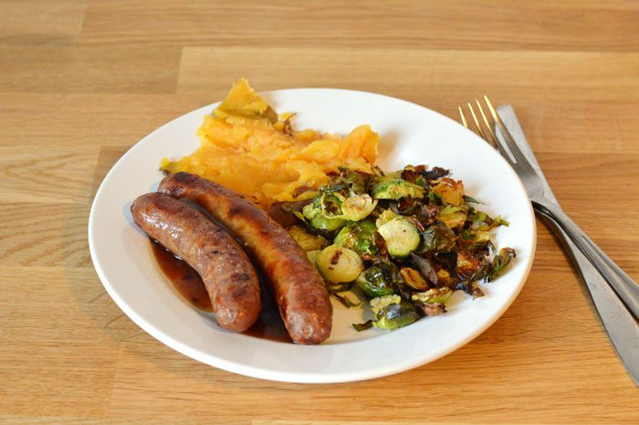 Lamb sausages with roast sprouts and sweet potato