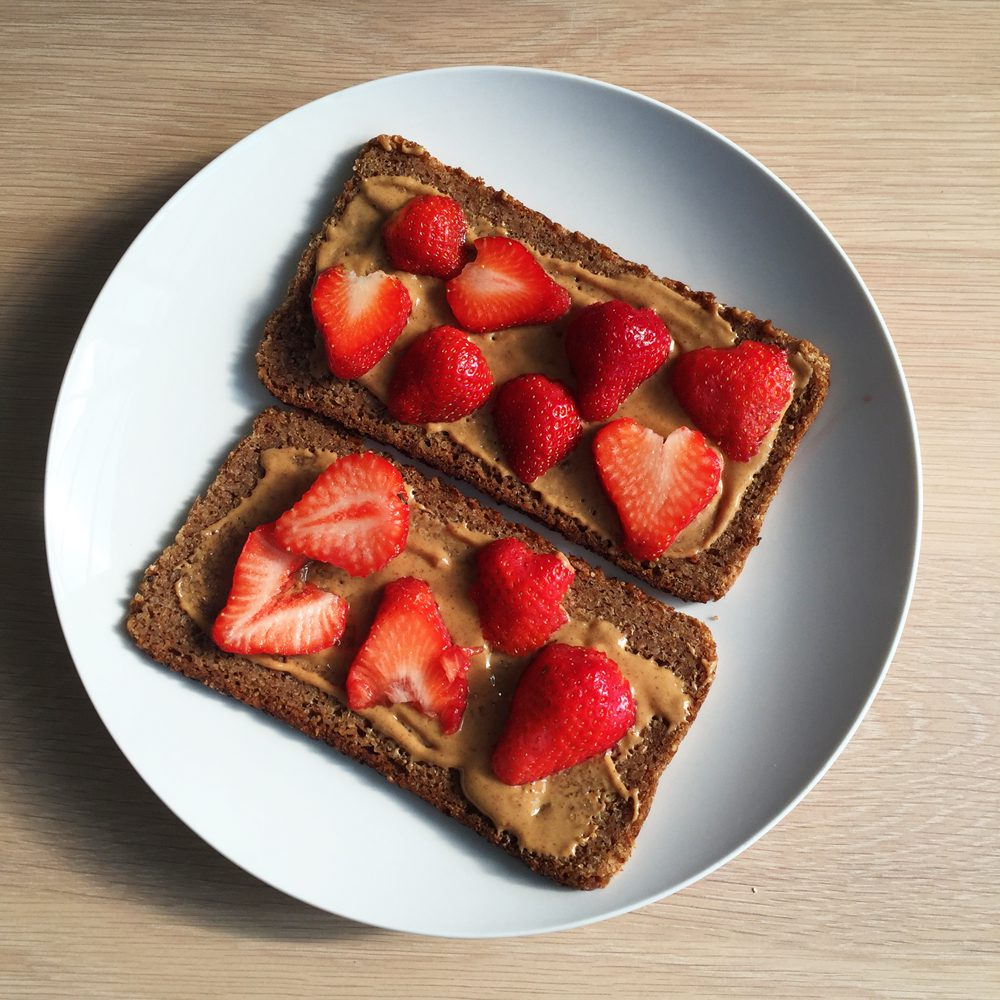 Strawberry almond butter on rye bread